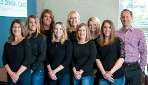 The Advance Dental Care of Anderson team posing for professional dental team photo