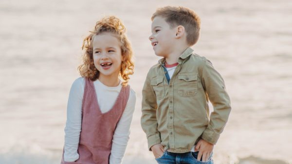 boy and girl smiling after dental extraction