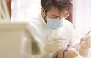 dentist working on patient's teeth-dental surgery