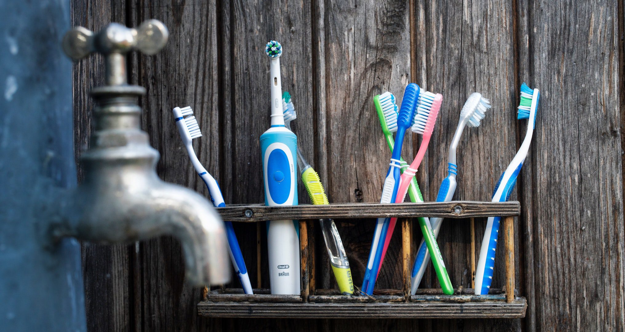 assortment of toothbrushes on a shelf