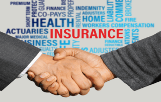 men shaking hands in front of words describing insurance