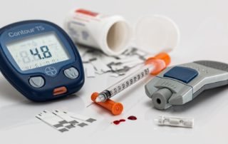 glucometer, insulin shot, pill bottle